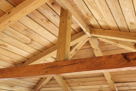 sloping: Interior view of a wooden roof structure