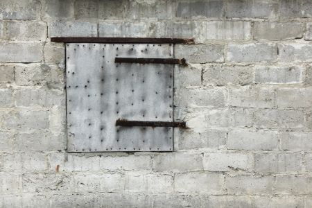 Old uneven wall with old shutter
