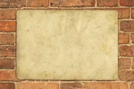 partment: old paper on old red brick wall - full scale background