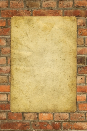 old paper on old red brick wall - full scale background