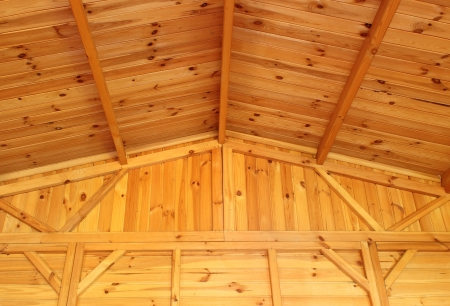 rafters: Interior view of a wooden roof and wall structure Stock Photo