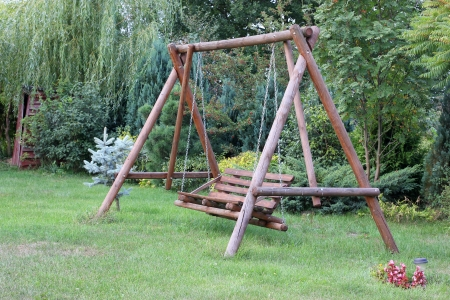 wooden teeter in garden photo