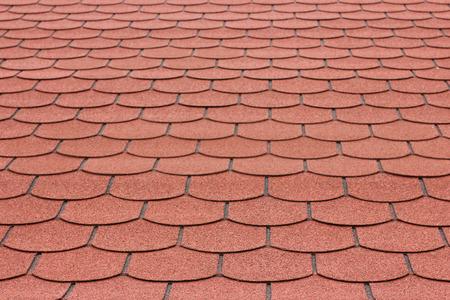 asphalt shingles: A view of red asphalt shingle