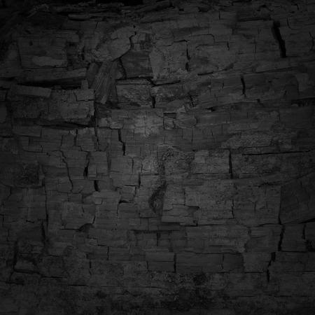木炭テクスチャと背景黒ムラ 写真素材