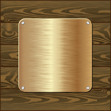 brass plate: golden plaque on dark wooden wall