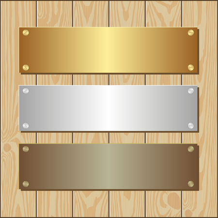 plaques: golden, silver and bronze plaques on wooden background