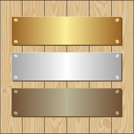 placa bacteriana: oro, plata y bronce placas en el fondo de madera