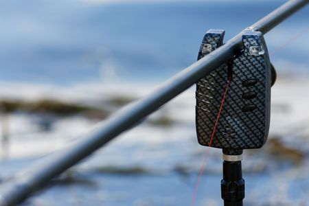 Electronic fish bite alarm on blurred background