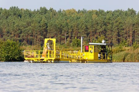 specialist dredging machine floating on the lake