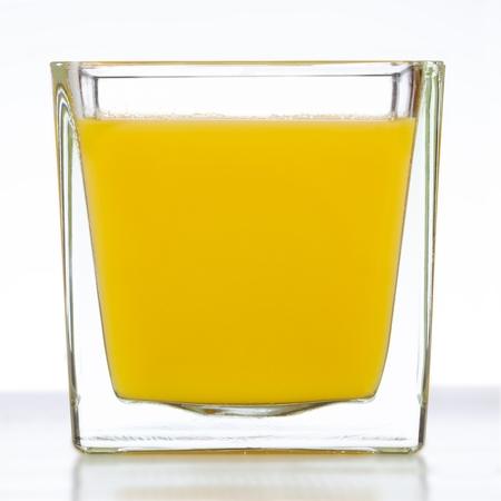 Full glass of orange juice on white 版權商用圖片