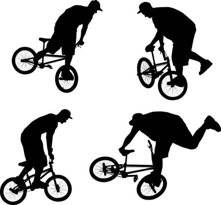 silhouette of cyclist doing bike trick on BMX bicycle