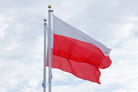 Two Poland national flags flying Stock Photo