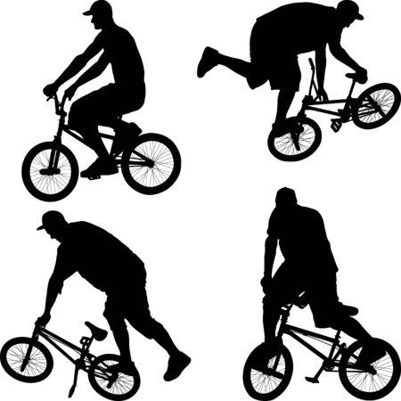 Macho haciendo truco en bicicleta en bicicleta BMX