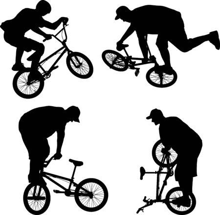 boy doing bike trick on BMX bicycle