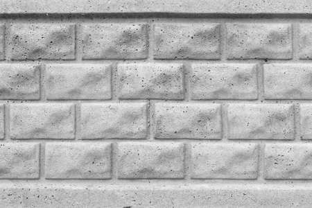 gray brick wall closeup, concrete background