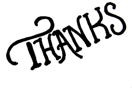 The word Thanks handwritten on piece of paper