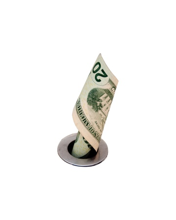 Twenty dollar bill going down the drain, isolated, with room for copy Stock Photo - 8813404