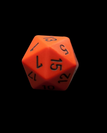 polyhedral dice on black background