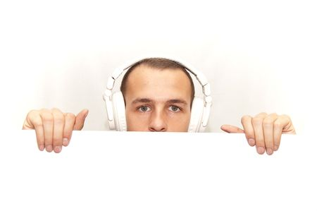 DJ behind his white desk Stock Photo