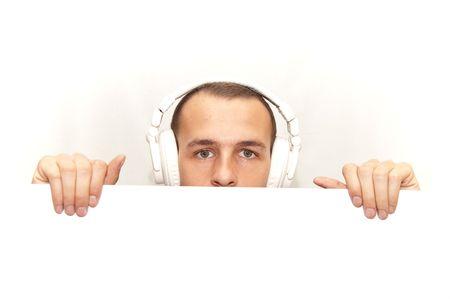 DJ behind his white desk Stock Photo
