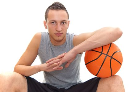 basketball player resting on the  ball, isolated on white, other images in my portfolio