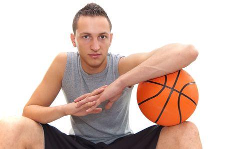 with orange and white body: jugador de baloncesto de descanso en el bal�n, aislados en im�genes de blancas, otras en mi cartera