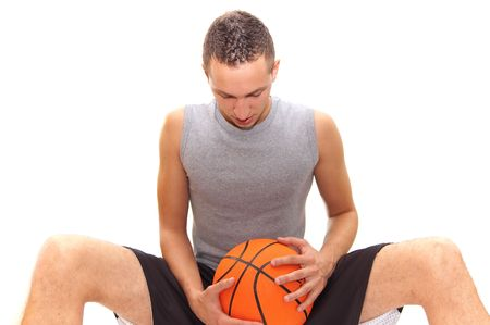 basketball player resting on the  ball, isolated on white, other images in my portfolio photo