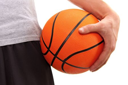 close up of a orange basketball held by a player