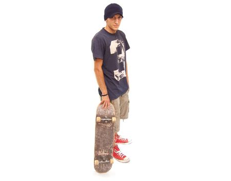 skater posing with a skateboard on white background Stock Photo