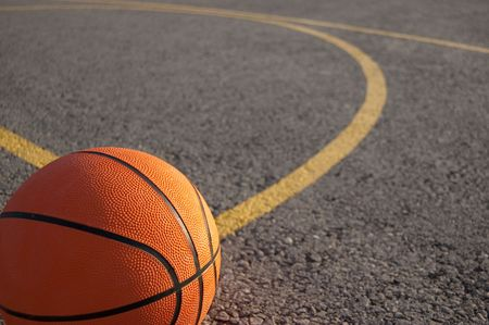 outdoor basketball court: photo of a orange basketball Stock Photo