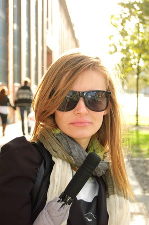 Portrait of a beautiful young woman wearing sunglasses. Stock Photo