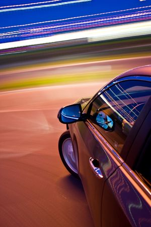 car driving fast in the night photo