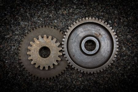 Set of gears on sand background Stock Photo - 3387375