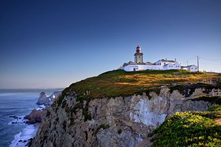 Dramatic view of cliffs and light on Cabo da Roca cape in Portugal on sunrise photo