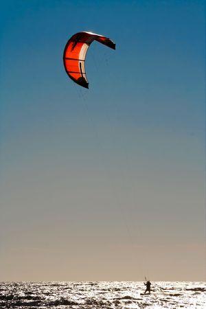 Kite surfer. Evening bright sun. Stock Photo - 3426861