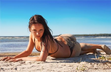 Hot model in bikini with a sandy back Stock Photo - 3541335