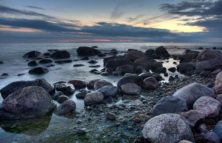 Mysterious view of stones and pebbles in  after sunset. Stock Photo - 3541340