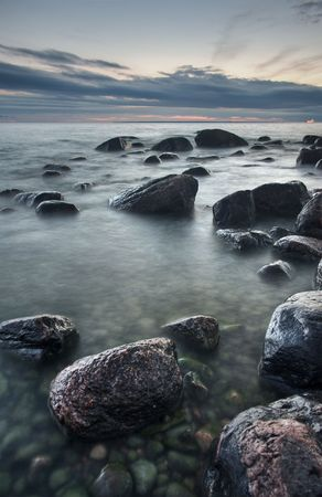 Mysterious view of stones and pebbles in  after sunset. Stock Photo - 3541240