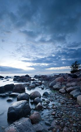 Mysterious view of stones and pebbles in  after sunset. Stock Photo - 3541341