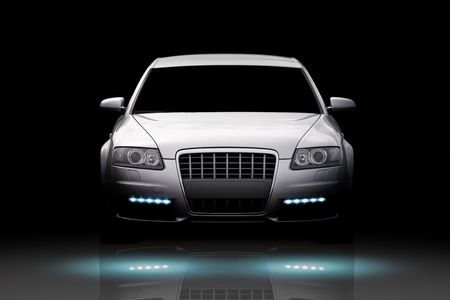 Front view of a luxury sport sedan isolated on black Editorial
