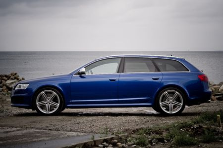 Side view of a high performance  estate car on a seashore