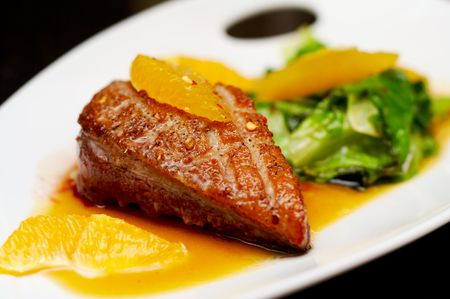Roasted duck breast fillet with miso-orange sauce and fried bokchoy Stock Photo - 3611797