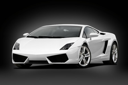 34 view of white supercar on black background