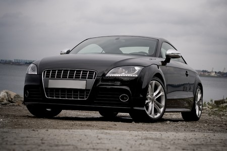Black sport coupe on a sea shore Stock Photo - 4180747