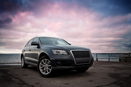Luxury SUV near the sea with dramatic sunset sky Editorial