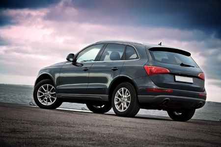 Rear view of a luxury SUV near the sea with dramatic sunset sky Stock Photo - 4262701