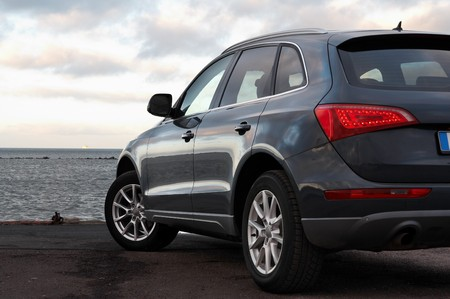 Rear view of a luxury SUV parked near the sea