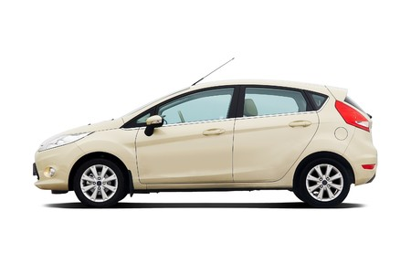 Beige 5-door compact hatchback isolated on white