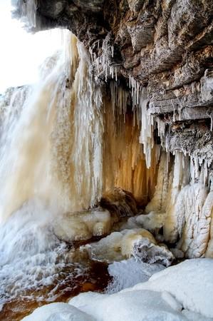 Wall of limestone and frozen waterfall Stock Photo - 4362273