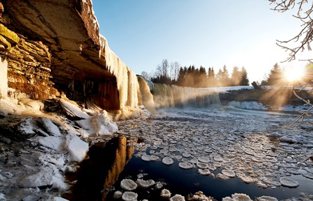 Icy winter waterfall in light of evening sun Stock Photo - 4362308